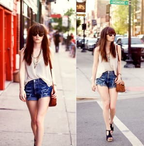 High waisted shorts with a tucked in blouse places emphasis on the hips