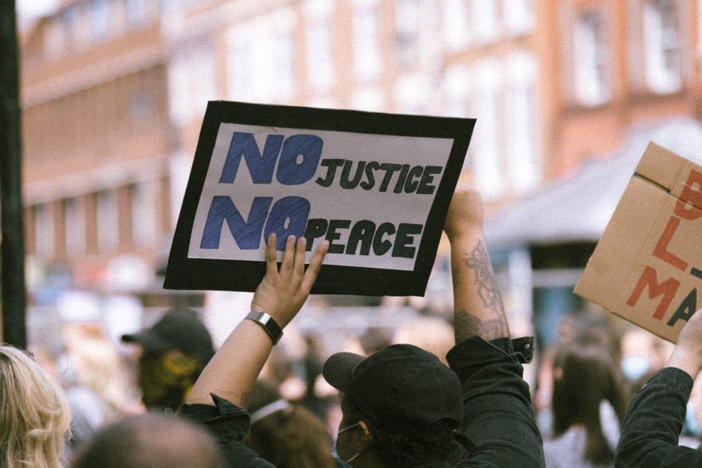 protest sign no justice no peace