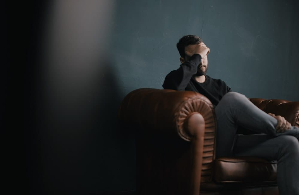 man distressed mental health therapy male depression